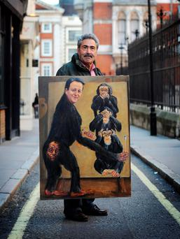 Artist Kaya Mar holds his painting depicting Prime Minister David Cameron at the Leveson Inquiry into press standards at the Royal Courts of Justice in London -a similar non-parliamentary inquiry here in relation to the media's role in the bank crash would have merit.