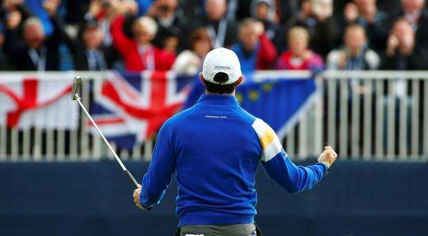 European Ryder Cup player Rory McIlroy celebrates winning the sixth hole against Rickie Fowler at Gleneagles