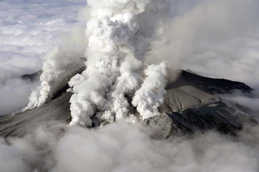 Dense plumes are spewed out from Mount Ontake as the volcanic mountain erupts in central Japan Saturday, Sept. 27, 2014. The 3,067-meter (10,062-foot) peak erupted in spectacular fashion on Saturday, catching climbers by surprise and stranding dozens injured people in areas that rescue workers have been unable to reach. (AP Photo/Kyodo News) JAPAN OUT, MANDATORY CREDIT