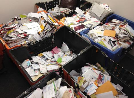 Pieces of mail that New York City mailman Joseph Brucato allegedly stashed away in his home and car over nearly a decade