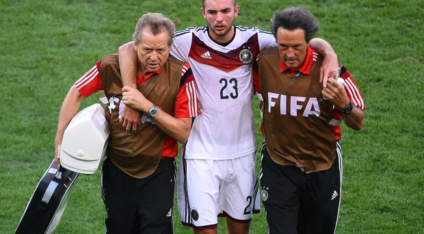 Christoph Kramer is helped from the pitch after suffering a concussion during the World Cup final against Argentina. Photo: CHRISTOPHE SIMON/AFP/Getty Images