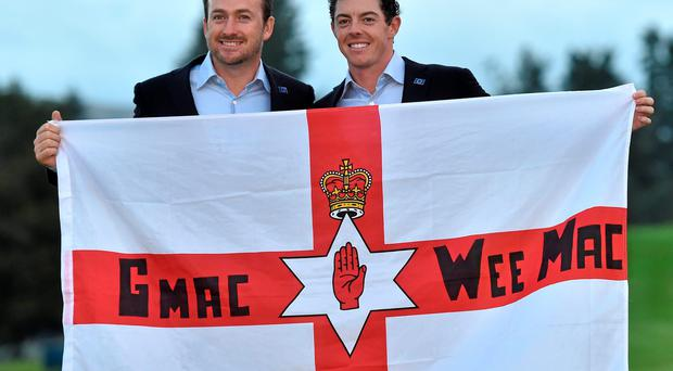 European team players Graeme McDowell and Rory McIlroy celebrate winning the Ryder Cup