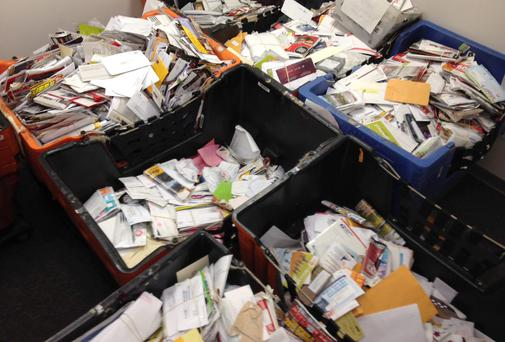 Pieces of mail that a New York City mailman allegedly stashed away in his home and car over nearly a decade