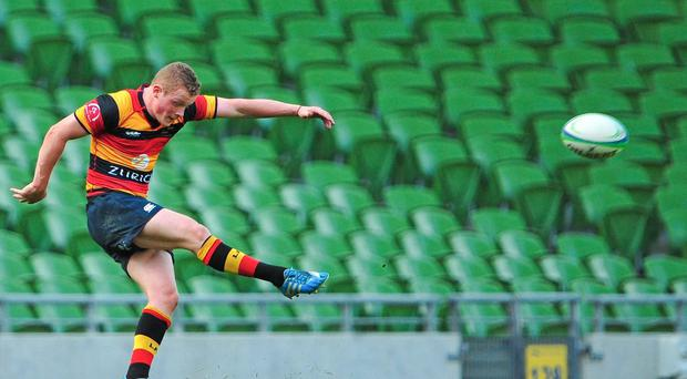 Conor McKeon kicks the winning point for Lansdowne against Clontarf during their Ulster Bank League Division 1A clash at the Aviva Stadium. Photo: Cody Glenn / SPORTSFILE