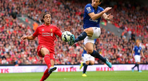 Everton's Leighton Baines takes on Lazar Markovic of Liverpool on Saturday. Alex Livesey/Getty Images