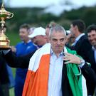 Paul McGinley gets his hands on the Ryder Cup. Ross Kinnaird/Getty Images