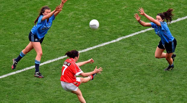 Cork's Geraldine O'Flynn shoots past Dublin's Leah Caffrey, left, and captain Sinéad Goldrick to score what proved to be the winning point in the All-Ireland ladies final at Croke Park. Ray McManus / SPORTSFILE