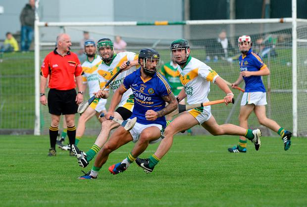 Lixnaw's Paul Galvin turns away from Sean Nolan of Kilmoyley during the Kerry hurling championship final at Austin Stack Grounds in Tralee. Photo: Domnick Walsh / Eye Focus Ltd