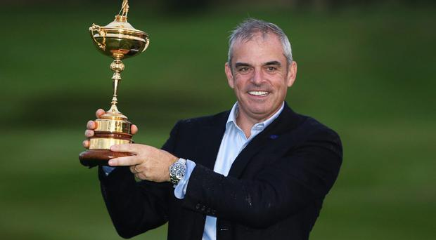 Europe captain Paul McGinley poses with the Ryder Cup after his team secured victory over the United States at Gleneagles. Photo: Ross Kinnaird/Getty Images