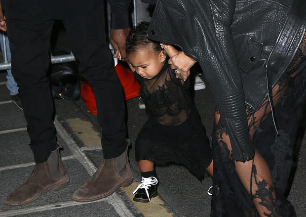 Kim Kardashian, Kanye West and their daughter North West come back from the Givenchy fashion show at their apartment