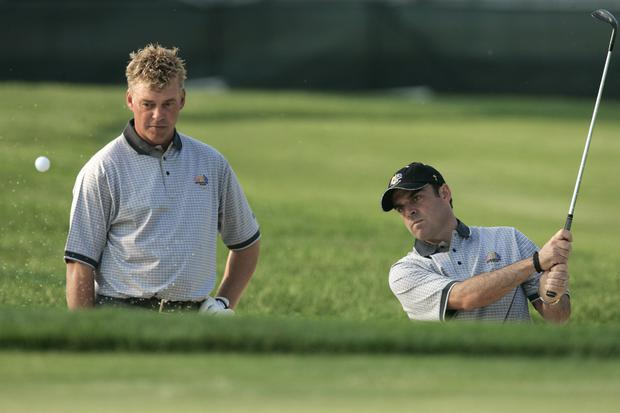 Europe team Ryder Cup team members Darren Clarke (L) of Northern Ireland and Paul McGinley of Ireland practice for the 35th Ryder Cup Matches at the Oakland Hills in 2004.