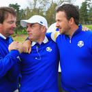 Caddie Ken Comboy, Europe team captain Paul McGinley and Graeme McDowell of Europe celebrate winning the Ryder Cup during the Singles Matches of the 2014 Ryder Cup on the PGA Centenary course at Gleneagles