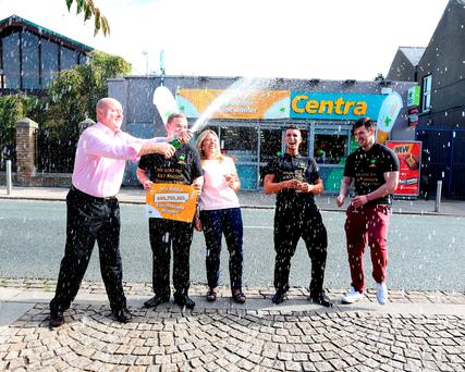 Dave Whelan, owner, Centra; Dean OíConnor, shop assistant; Karen Whelan, wife of owner; Simon Collier, shop manager and Emmet Smiles. Pic: Mac Innes Photography