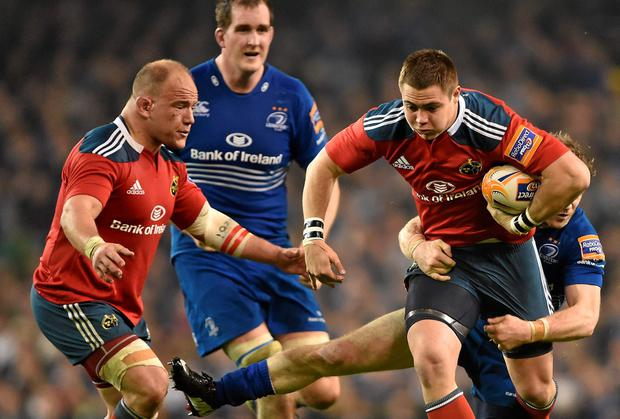 Munster's Gerhard van den Heever, supported by BJ Botha (left), is tackled by Gordon D'Arcy during last season's Pro12 clash in the Aviva Stadium. Picture credit: Brendan Moran / SPORTSFILE