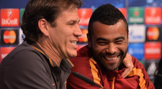 Roma manager Rudi Garcia jokes with Cole during yesterday's pre-match press conference. Photo credit: PAUL ELLIS/AFP/Getty Images