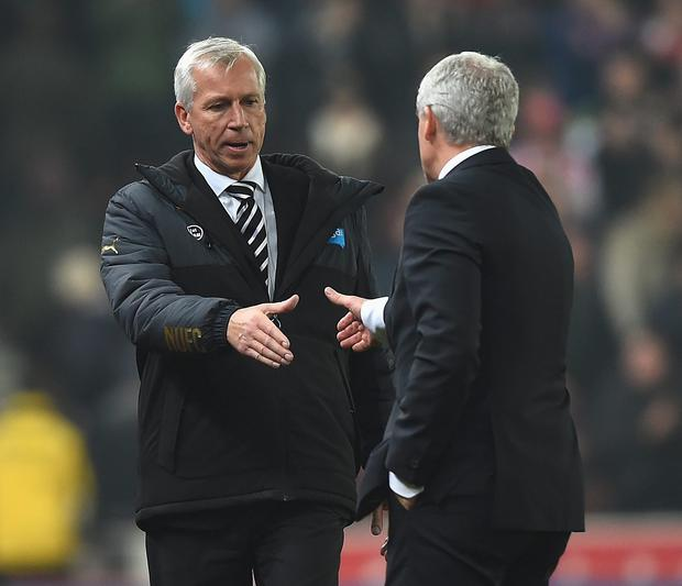 STOKE ON TRENT, ENGLAND - SEPTEMBER 29: Alan Pardew, manager of Newcastle United shakes hands with Mark Huges, manager of Stoke City after the Barclays Premier League match between Stoke City and Newcastle United at Britannia Stadium on September 29, 2014 in Stoke on Trent, England. (Photo by Laurence Griffiths/Getty Images)