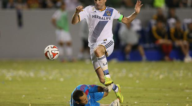 New York Red Bulls goalkeeper Luis Robles makes a save to foil Robbie Keane during Sunday night's match at the StubHub Center in Los Angeles. Photo credit: Jeff Gross/Getty Images