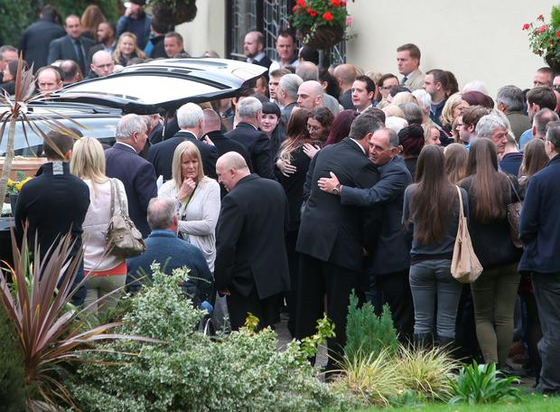 Mourners outside St Fergals Church in Bray after the funeral of David Costigan