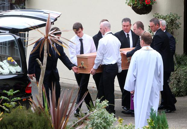 The coffin is carried from St Fergals Church in Bray after the funeral of David Costigan