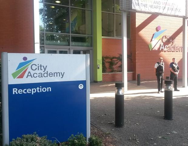 Two police officers outside The City Academy in Bristol, where a 15 year old girl believed to be travelling to Syria attends