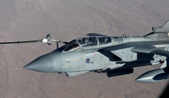 Two RAF Tornado GR4s fly during their first combat mission flown out of Akrotiri, Cyprus