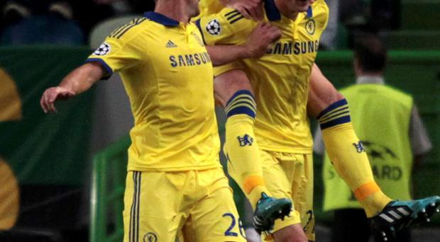 Chelsea's Nemanja Matic (bottom R) celebrates with team mates after scoring a goal against Sporting Lisbon during their Champions League Group G soccer match at the Estadio Jose Alvade in Lisbon, September 30, 2014. REUTERS/Hugo Correia (PORTUGAL - Tags: SPORT SOCCER)
