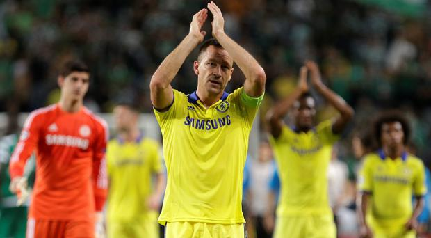Chelsea's John Terry celebrates his side's 1-0 win at the end of a Champions League, Group G soccer match between Sporting and Chelsea, in Lisbon, Tuesday, Sept. 30, 2014. (AP Photo/Francisco Seco)