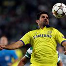 Chelsea's Diego Costa goes for the ball during a Champions League, Group G soccer match between Sporting and Chelsea last night