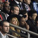 US rapper and record producer Jay-Z (C), his wife US singer Beyonce and former England forward David Beckham (R) attend the UEFA Champions League football match between Paris Saint-Germain (PSG) and Barcelona at the Parc des Princes stadium in Paris on September 30, 2014. AFP PHOTO / FRANCK FIFE (Photo credit should read FRANCK FIFE/AFP/Getty Images)