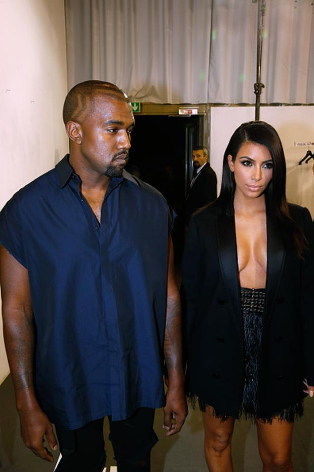 Kanye West and Kim Kardashian pose backstage before the Lanvin show as part of the Paris Fashion Week Womenswear Spring/Summer 2015