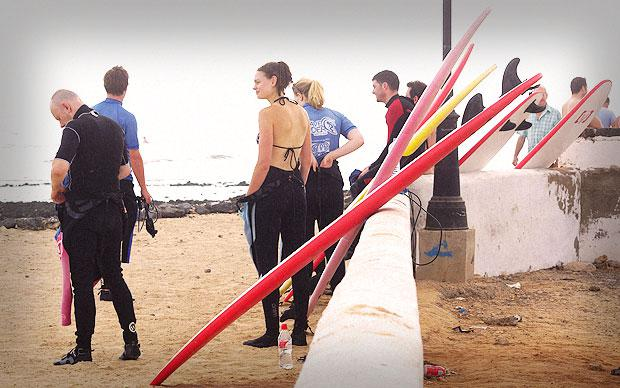 The group suits up ahead of the day's surfing