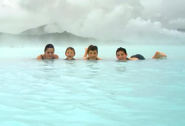 Iceland: Family bathing in a geothermal pool