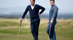 ST ANDREWS, SCOTLAND - OCTOBER 2: Robert Rock of England and Brian O'Driscoll on the 17th green during the first round of the 2014 Alfred Dunhill Links Championship at The Old Course on October 2, 2014 in St Andrews, Scotland. (Photo by Ross Kinnaird/Getty Images)