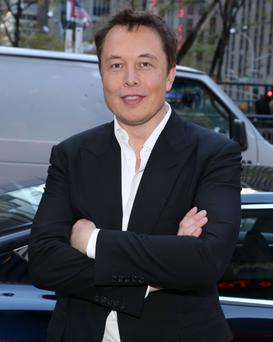 NEW YORK, NY - SEPTEMBER 17: Entrepreneur Elon Musk poses in front of a Tesla outside of 1211 Avenue of the Americas on September 17, 2014 in New York City. (Photo by Taylor Hill/GC Images)