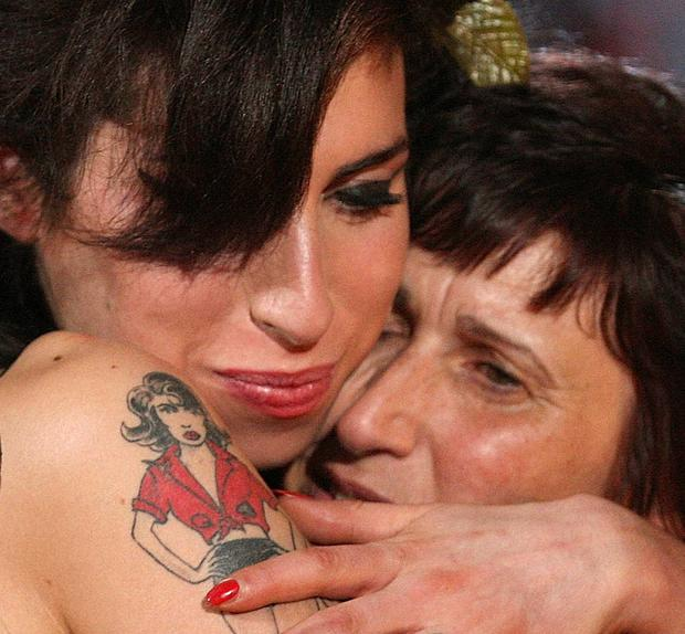 Amy Winehouse hugs her mother Janis after accepting a Grammy Award