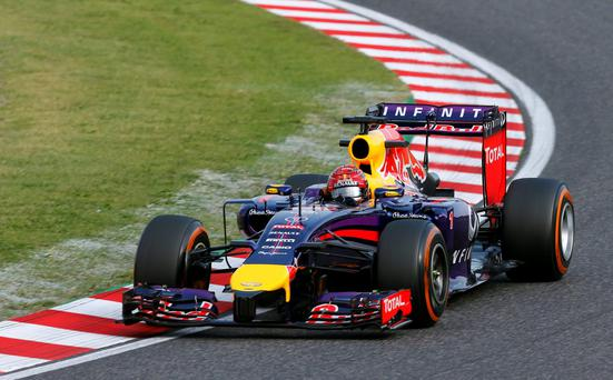 Red Bull Racing driver Sebastian Vettel steers his car during the second practice session for Sunday's Japanese Formula One Grand Prix at the Suzuka Circuit, Japan