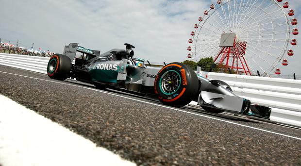 Lewis Hamilton at practice yesterday ahead of tomorrow's Japanese Grand Prix. Clive Rose/Getty Images