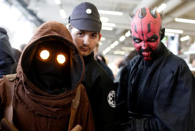 A group of people dressed as a Star Wars characters pose at the cartoon fair