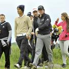 Hard driver: Rory McIlroy practises with his best friend Harry Diamond, while Katie Larmour follows at Royal Portrush. Photo: Russell Pritchard/Presseye