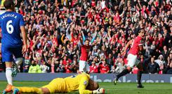 Radamel Falcao celebrates scoring his team's second goal against Everton at Old Trafford