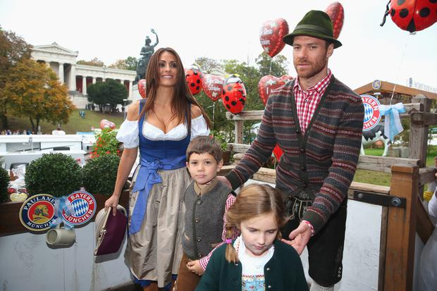 Xabi Alonso attends with his wife Nagore Aramburu the Oktoberfest beer festival