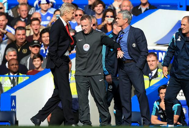 Arsenal boss Arsene Wenger and Chelsea manager Jose Mourinho get caught up in a heated exchange last year