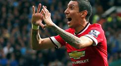 Angel Di Maria celebrates after scoring Manchester United's opening goal against Everton in the Premier League clash at Old Trafford. Photo: REUTERS/Phil Noble