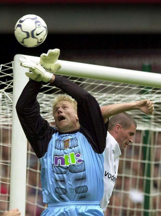 Aston Villa's Peter Schmeichel and Manchester United's Roy Keane clash in 2001