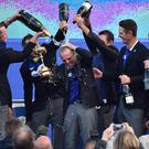 Paul McGinley is doused in champagne by his victorious Ryder Cup team at Gleneagles. Photo: BEN STANSALL/AFP/Getty Images