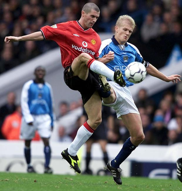 Manchester United's Roy Keane in action against Manchester City's Alfie Haaland in 2000