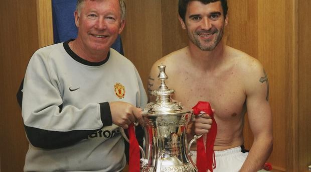 Roy Keane and Alex Ferguson with one of many trophies at Old Trafford