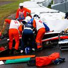 Marussia driver Jules Bianchi receives urgent medical treatment after crashing during the Japanese Grand Prix at Suzuka. Photo: Getty Images/Getty Images