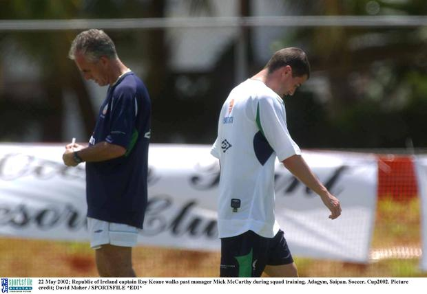 22 May 2002; Republic of Ireland captain Roy Keane walks past manager Mick McCarthy during squad training. Adagym, Saipan. Soccer. Cup2002. Picture credit; David Maher / SPORTSFILE *EDI*