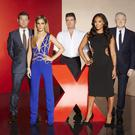 The X Factor on TV3 A Thames / Syco co-Production UNDER STRICT EMBARGO UNTIL 00.01 ON TUESDAY 26TH AUGUST 2014 X FACTOR on Saturday 30th August 2014 Picture Shows: DERMOT, CHERYL, SIMON, MEL B and LOUIS. The Uk's biggest search for a musical superstar gets underway as The X Factor returns to ITV this Autumn. The nations's most talked about entertainment show sees former 'frenemies' Simon Cowell and Cheryl reunited on the judging panel. They are joined by new signing , straight-talking Spice Girl Mel B, and renowned musical manager Louis Walsh, who returns for another series. Dermot O'Leary is also back to host the show with radio DJ Sarah Jane Crawford presenting the ITV2 spin-off The Xtra Factor. Photographer : Nicky Johnston ©ITV
